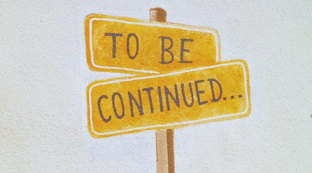「続く」と書かれた看板の絵